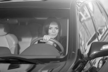 Girl in a  car in glasses