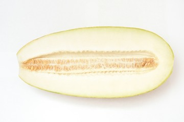 Beautiful and ripe yellow melon on a white background. Cut. With seeds