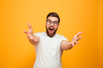 Portrait of an excited bearded man in eyeglasses Wall mural