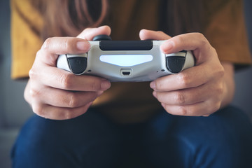 Closeup image of hands holding the game controller while playing games