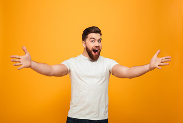 Portrait of a cheerful bearded man with outsretched hands