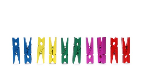 Colorful wooden clothespins isolated on white background