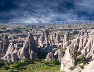 Unique geological formations in Red valley, Cappadocia, Anatolia, Turkey