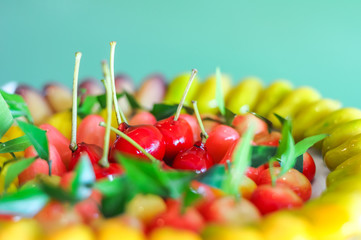 Close up deletable imitation fruits arrange on plate background, Look Choup Thai sweets