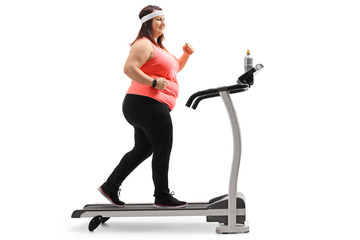 Overweight woman exercising on a treadmill