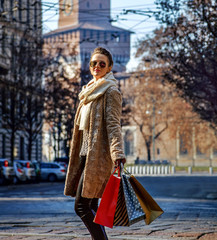 elegant woman in Milan, Italy looking into distance and walking