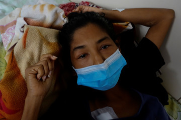 Yasmira Castano, 40, who lost her transplanted kidney, lies on a bed at a state hospital in Caracas