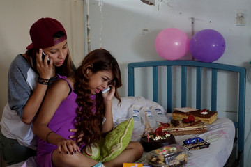 Lismar Castellanos, 21, who lost her transplanted kidney, cries while she speaks on the phone with a relative during her birthday celebration at a state hospital in Caracas