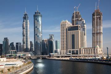 Dubai, UAE - FEBRUARY 2018: Dubai Downtown skyscrapers as viewed from the Dubai water canal.