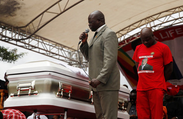 A pastor prays besides the coffin of Movement For Democratic Change (MDC) leader, Morgan Tsvangirai, during his funeral in Buhera
