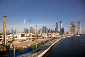 DUBAI, UAE - FEBRUARY, 2018: Construction activity in Dubai along the water canal.