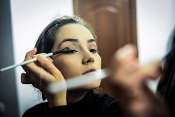 Girl doing makeup