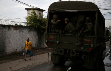 Members of the armed forces patrol the Kelson's slum during an operation against crime in Rio de Janeiro