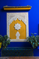 Architectural detail of a decorated blue wall at sunset in Majorelle garden, Marrakech, Morocco, Africa