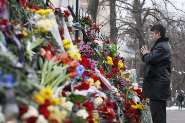 A man attends a commemoration ceremony at the monument to the people killed during the 2014 Ukrainian pro-European Union protests in Kiev