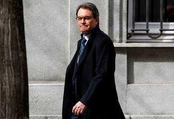 Former Catalan president Artur Mas leaves the Supreme Court after appearing before a judge in Madrid
