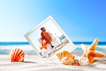 two lovers on beach and shells on sand