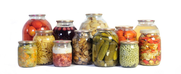 collection various canned vegetables in glass jars isolated on white