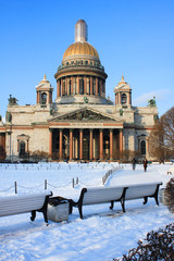 St. Petersburg Saint Isaac's Cathedral View in Russia. Outdoor Winter Scene of Russian Classical Architecture, Orthodox Basilica and Museum. View from Local Park Square on Cold Winter Snowy Day.