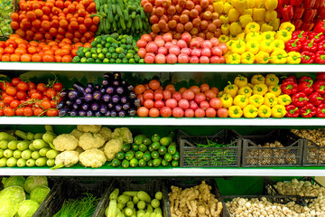 Fresh organic Vegetables and fruits on shelf in supermarket, farmers market. Healthy food concept. Vitamins and minerals. Tomatoes, capsicum, cucumbers, mushrooms, zucchini,