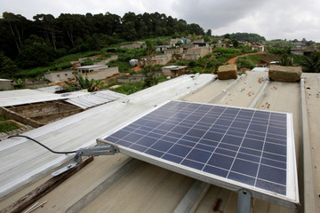 A solar panel is pictured on the roof of Jean-Noel Kouame's house, on the outer limits of the main city Abidjan's vast urban sprawl