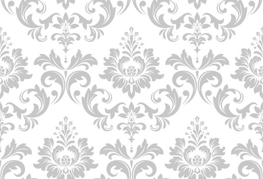 Wallpaper in the style of Baroque. A seamless vector background. White and grey floral ornament. Graphic vector pattern.
