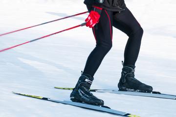 Ski race. A man running on skis.Tonification.