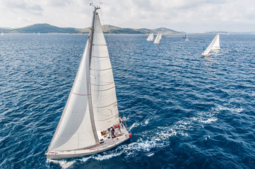 Sailing boats from bird view on open sea