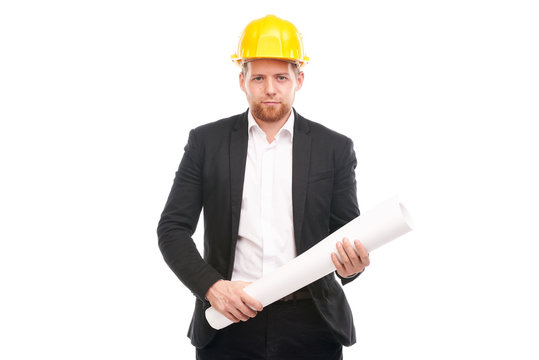 Portrait of architect wearing suit and yellow hardhat holding project plan on white background
