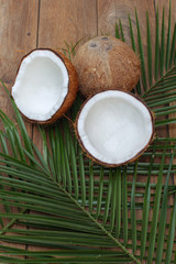 Coconut isolated on the wooden background. Tropical fruit coconut