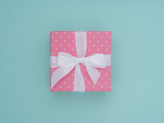 Wrapped vintage gift box. Copy space. Pastel  Colour flat lay minimal concept. Pink rose.