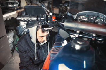 Motorcycle repair in the garage