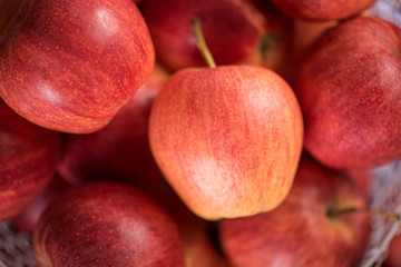close up of red fruit apples on a wood background