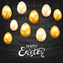 Golden Easter eggs on black chalkboard background