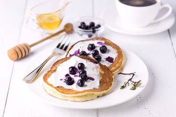 Pancakes Topped with Cream Cheese Honey and Blueberries on Plate White Background Homemade Tasty Pancakes Tasty Breakfast