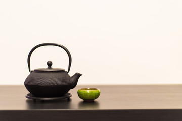 Teapot for Japanese or Chinese tea ceremony with a cup