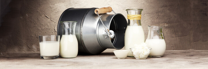 Poster Produit laitier milk products. tasty healthy dairy products on a table on