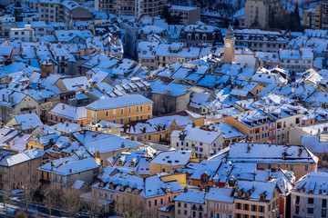 Aerial Winter view of snow covered rooftops in the city of Gap. Hautes-Alpes, Alps, France