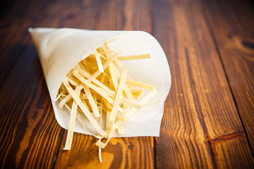 homemade egg noodles in a paper package