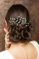 Picture from back of girl with hairdo and diadem