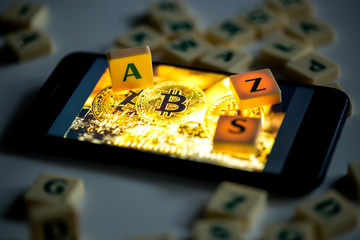 Concept of using bitcoins on a smartphone. Letters on blocks as a block symbol in a blockchain system.