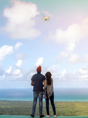 Brazil, Natal, February 19,2018 Ocean View, A man and a girl launch a drone