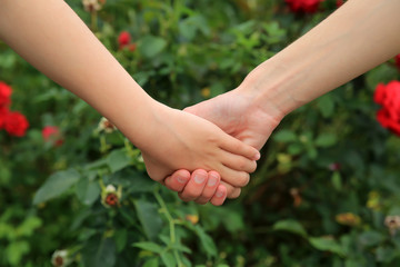 Mother and daughter hands together