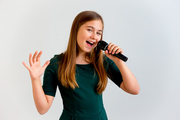 Girl singing with a microphone