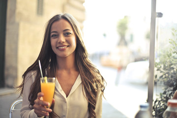 Pretty woman holding a refreshing drink