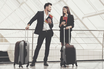 Business Travel. Business people at airport. Airport hall with panoramic windows.