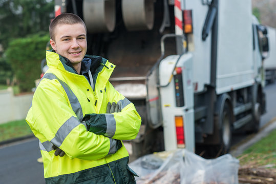 young garbage collector near truck