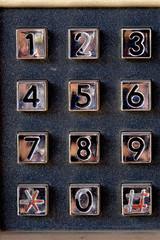 Phone number keypad at old street phone.