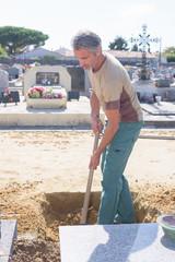 Man preparing grave