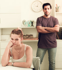 Woman at home table after quarrel with husband